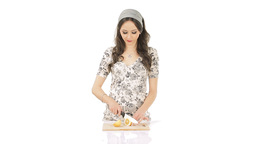 Young brunette chopping lemon Stock Video Footage