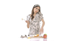 Young Brunette Chopping Apples While Speaking On Phone  stock footage