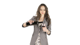 Brunette drinking red wine from a bottle Stock Video Footage