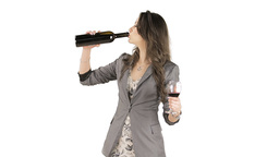 Brunette drinking red wine from a bottle Footage
