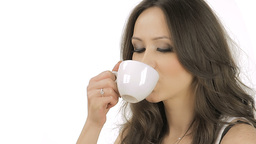 Brunette satisfied by the taste of the coffee Stock Video Footage