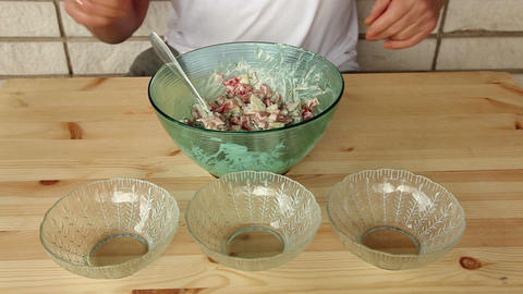 Distributing salad into small glass plates 8a Stock Video Footage