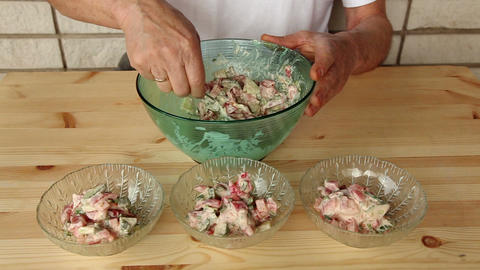 Distributing salad into small glass plates 8a Footage