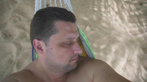Men swinging in hammok Stock Video Footage