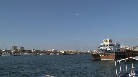 Airplane zoom out to traditional boats in Dubai Harbor Footage