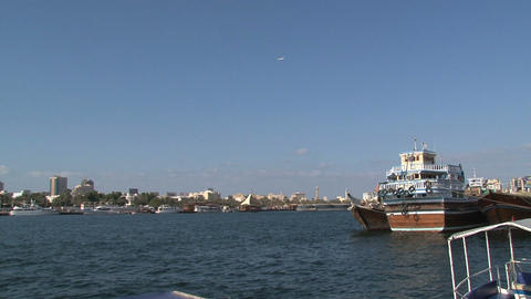 Airplane zoom out to traditional boats in Dubai Harbor Stock Video Footage