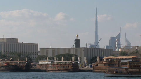 Boats with the burj khalifa at the backgournd Stock Video Footage