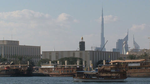 Boats with the burj khalifa at the backgournd Footage