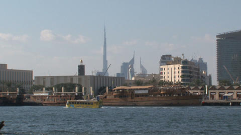 yellow waterbus in front of the Burj Khalifa Stock Video Footage