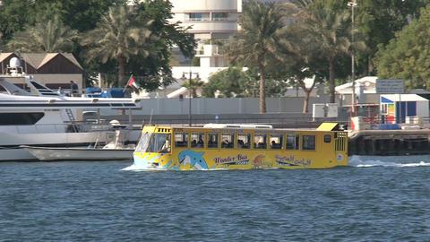 Yellow waterbus in harbor Dubai Stock Video Footage