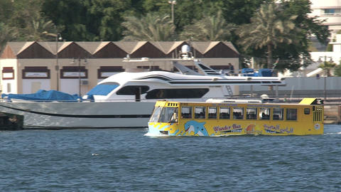 Yellow waterbus in harbor Dubai Footage