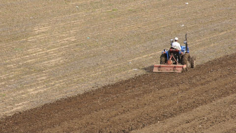Tractor plowing the field 07 Stock Video Footage