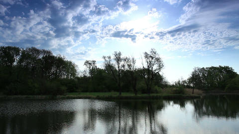 Movement of clouds over the river Black Stallion. Donetsk region, Ukraine (timelapse) Footage