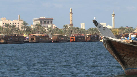 Yellow water boat bus passing in harbor Dubai Stock Video Footage