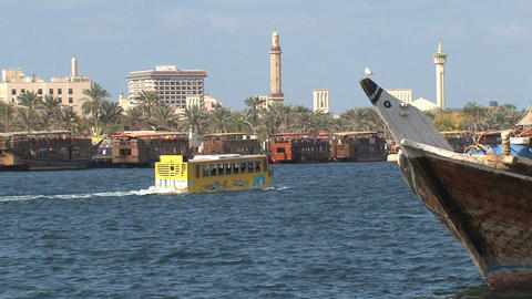 Yellow water boat bus passing in harbor Dubai Footage