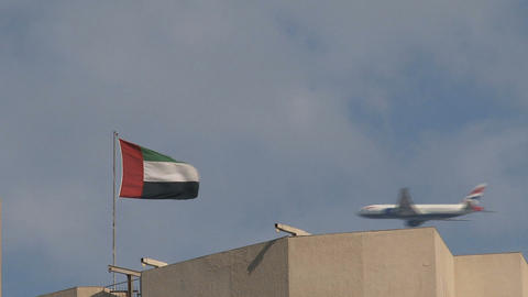 Airplane behind United Arab Emirates flag Footage