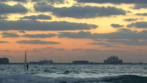 Surfer during sunset in Dubai Stock Video Footage