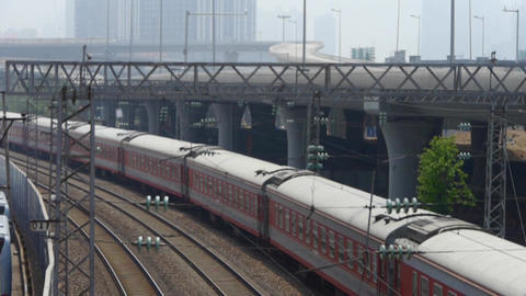 train waiting on rail & viaduct in haze pollution Stock Video Footage