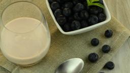 Yogurt and blueberries Stock Video Footage