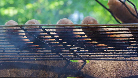 Turning around sausages on grill Stock Video Footage