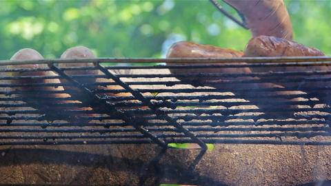 Turning Around Sausages On Grill stock footage