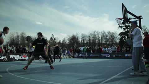 Teenagers playing basketball 2 Stock Video Footage