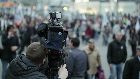Cameraman shoots people at a crowded place Stock Video Footage