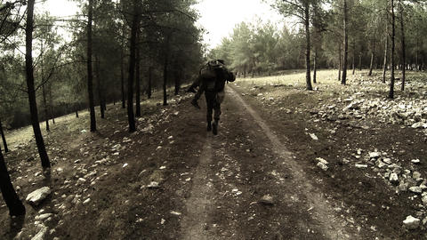armed soldiers walking through field. soldiers running with Machine gun weapons Footage