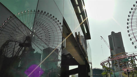 Yokohama Cosmoworld Ferry Wheel Japan pan Stock Video Footage