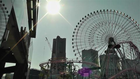 Yokohama Cosmoworld Ferry Wheel Japan pan Stock Video Footage