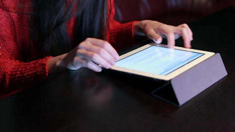 girl in a restaurant with a tablet Stock Video Footage