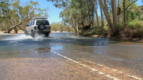 Four wheel drive driving to water, Australia Footage