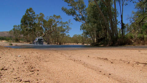 Four wheel drive driving to the water, Australia Stock Video Footage