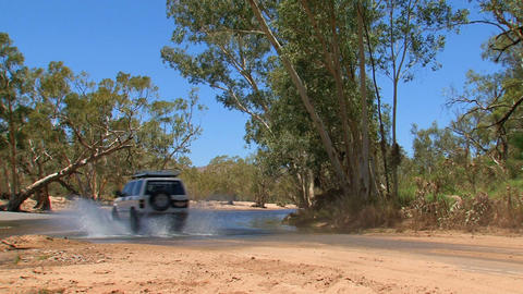 Four wheel drive driving to water Stock Video Footage