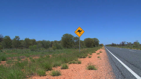 Blue car passing by Kangaroo sign Stock Video Footage