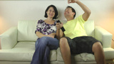 Cute couple watching TV in the living room Stock Video Footage