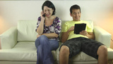 Couple using smartphone and tablet Stock Video Footage