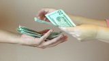 Hands giving money Stock Video Footage