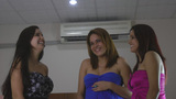 Three female friends enjoying together at night Stock Video Footage