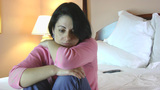 Sad woman on the bed Stock Video Footage