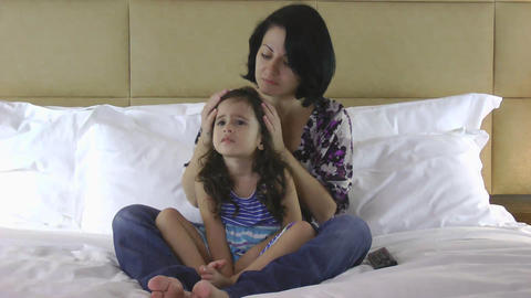 Mother and daughter watching scary movie on the bed Stock Video Footage