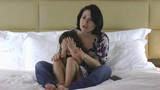 Mother And Daughter Watching Scary Movie On The Bed stock footage