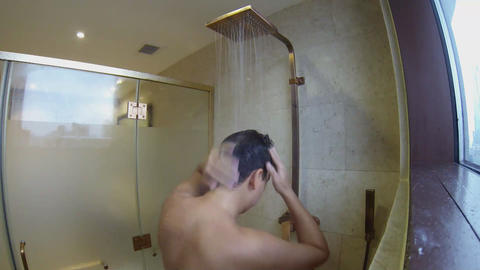 Man taking a shower Stock Video Footage