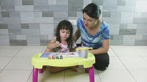 Mother teaching her little daughter to paint Stock Video Footage