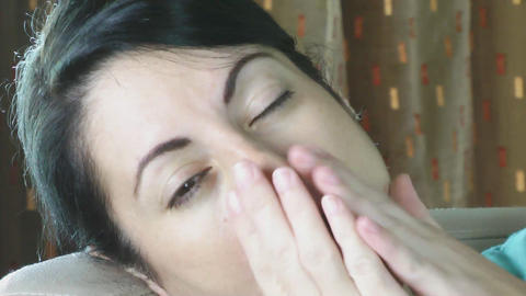 Close up of sleepy eye of a woman yawns Stock Video Footage