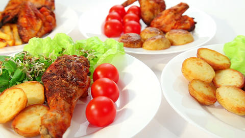 Roasted chicken with potatos chips salad and tomatoes Stock Video Footage