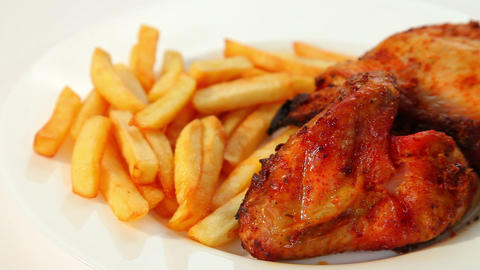 Roasted chicken wings and chips Stock Video Footage