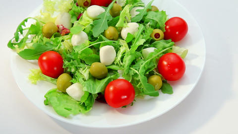 Salad with mozarella cheese - plate with vegetables salad Footage