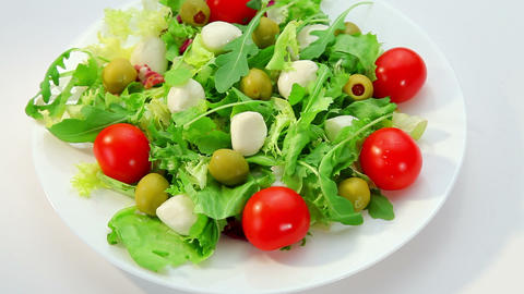 Salad with mozarella cheese - plate with vegetables salad Stock Video Footage