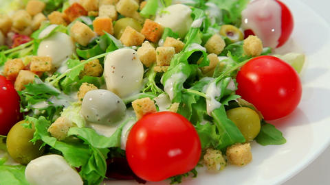 Salad with mozarella cheese - plate with vegetables salad and dressing Footage